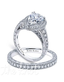 Hand-engraved engagement set from the Kirk Kara Carmella collection. Engagement ring is crafted with 0.40 carats of diamonds (center stone not included). Shown with matching wedding band crafted with 0.17 carats of diamonds.  Available in platinum or 18K white, 18K yellow or 18K rose gold. All Kirk Kara designs are handcrafted and tailored to accommodate your customization requests.