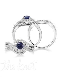 Dance the night away! The Twirl is a 0.60 carat round blue sapphire set in a 14K white gold band adorned with 81 diamond inlays with a combined 0.44 carats. Perfect for the one you call your sweetheart. Don't be afraid to customize - this ring is also available in pink sapphire, ruby, and emerald as well as in 14K yellow gold. Add a little tint to your style with Parlé Color Bridal! Blue Sapphire
