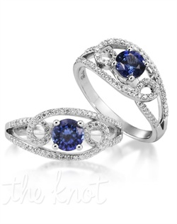 The world in your hand! The Galaxy spotlights a 14K white gold band with a 0.87 carat round blue sapphire center stone. Bordered by 74 looped diamonds with a combined .3 carats, the Galaxy takes passion to a whole new level! Don't be afraid to customize - this ring is also available in pink sapphire, ruby, and emerald as well as in 14K yellow gold. Add a little tint to your style with Parlé Color Bridal!