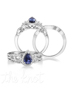 Heart throbbing. The Flutter features a 1.00 carat pear cut blue sapphire center stone in a 14K white gold band. Surrounded by 61 additional diamonds intricately weaved together, the Flutter will keep them talking! Don't be afraid to customize - this ring is also available in pink sapphire, ruby, and emerald as well as in 14K yellow gold. Add a little tint to your style with Parlé Color Bridal!