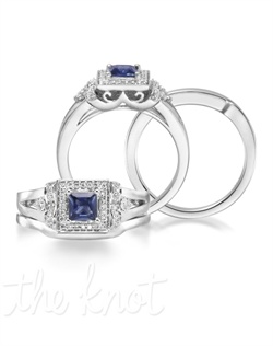 "Endless affection. The Evermore showcases a 0.47 carat Princess cut blue sapphire center stone with a 14K white gold band. Encompassed by 42 diamonds with a combined 0.22 carats, the Evermore can bring out the ""Duchess"" in you! Don't be afraid to customize - this ring is also available in pink sapphire, ruby, and emerald as well as in 14K yellow gold. Add a little tint to your style with Parlé Color Bridal!"