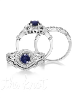 Spellbinding. The Entranced lives up to its name! This 14K white gold engagement ring features a 0.60 carat round blue sapphire set in a diamond-covered band that's sure to take your breath away. Delightful for any occasion. Don't be afraid to customize - this ring is also available in pink sapphire, ruby, and emerald as well as in 14K yellow gold. Add a little tint to your style with Parlé Color Bridal!