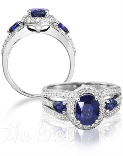 Elegance for your perfect day. The Enchanted is a 14K white gold eye-catcher with a 1.55 carat oval blue sapphire center stone. Flanked by additional blue sapphires and enveloped with diamonds, this ring is sure to captivate anyone. Don't be afraid to customize - this ring is also available in pink sapphire, ruby, and emerald as well as in 14K yellow gold. Add a little tint to your style with Parlé Color Bridal!