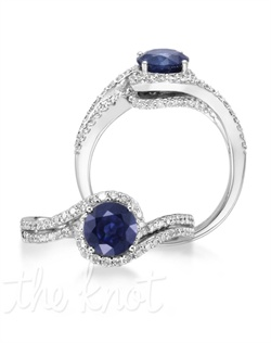 Beauty unmatched. The Caress is a 14K white gold dazzler with a 1.38 carat round blue sapphire wrapped in diamonds that would be perfect for the special someone in your life. Don't be afraid to customize - this ring is also available in pink sapphire, ruby, and emerald as well as in 14K yellow gold. Add a little tint to your style with Parlé Color Bridal!