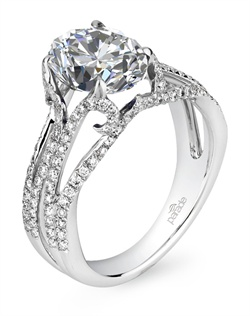 A sleek and modern engagement ring from the Hemera Collection features an open, wide band of diamonds elevating a 2.5 carat oval diamond. A curl of diamonds beneath each prong lends a touch of romantic whimsy to this otherwise bold design.  Available in platinum, 18K white, 18K yellow, 18K rose gold or palladium. All Parade Design styles can be customized upon request.