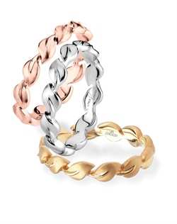 Parade Design's original Lyria® Leaves wedding band is featured in the 2012 release of The Vow, starring Rachel McAdams! Satin finished cascading leaves  are crafted in the finest 18K gold. Lyria® strikes a balance between strength and beauty, symbolizing a union that will last a lifetime. Shown in 18K rose, white and yellow gold.  Also Available in platinum or palladium. All Parade Design styles can be customized upon request.