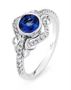 A bezel-set blue sapphire (0.87 ct)  adds vivacity to the award-winning Lyria® platinum design. It's the perfect pairing of sleek modernism with vintage romance. (0.30 ct tw - center stone not included). Available in platinum, 18K white, 18K yellow, 18K rose gold or palladium. All Parade Design styles can be customized upon request.