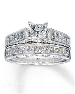 It has been nearly a century since Marcel Tolkowsky revolutionized diamond cutting with the original Ideal Cut Diamond. The tradition continues with the Tolkowsky® modern Princess Ideal Cut Diamond. To beautifully complement the Tolkowsky diamond in this engagement ring, additional channel-set, princess-cut diamonds flow along the 14K white gold band. The matching wedding band features round and princess-cut diamonds along the top and sides. The total diamond weight of this fine jewelry wedding set is 1 7/8 carats. Each Tolkowsky diamond ring comes with a certificate of authenticity and independent certification of the center stone.