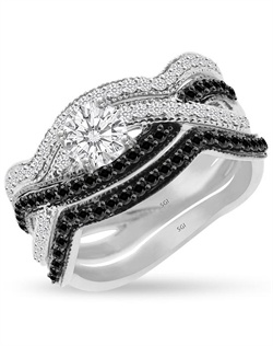 There is no better way to announce the joining of two individuals than by making a bold statement.  The 1/2ct center stone is wrapped on one side in black diamonds and the other side in white diamonds in this braided wedding ring with two bands.  Set with 0.29cts of Black diamonds and 0.25cts of Ideal Cut diamonds, F-G Color, SI1 Clarity set in 14Kt White  Gold.  The center stone is sold separately.