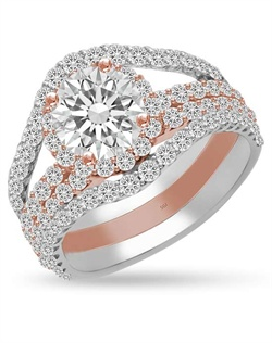 Not for the blushing bride.  Two bridges of diamonds raise the pink halo high showing off the center diamond while a double row of diamonds set in pink gold flow smoothly underneath the 1ct center stone.   1.59cts of Ideal Cut diamonds, F-G Color, SI1 Clarity set in 14Kt White and Pink Gold.  The center stone and matching wedding band are sold separately.