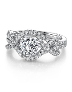 This stunning semi-mount is shown with a 1ct center diamond. Available in 18K white or yellow gold and platinum. Prong set for durability with diamonds calibrated to 1/100th of a millimeter. Settings can be custom made to fit any size or shape center stone. Total weight of semi-mount 0.79 Ct. Matching band available - Style number DR-335A