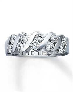 Ten round Leo diamonds are channel-set between sweeps of 14K white gold in this sensational ring for her. One carat total diamond weight. Independently Certified and laser-inscribed with a unique Gemscribe® serial number. The inside of the band features a round diamond within the Leo signature.