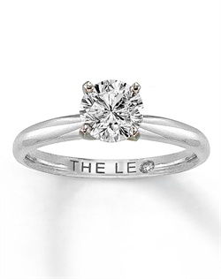This captivating fine jewelry ring features a stunning 1 carat round Leo Diamond secured by platinum prongs set in a high-polish 14K white gold band. The Leo Diamond is independently certified and laser-inscribed with a unique Gemscribe® serial number.