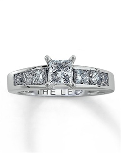 A stunning princess-cut Leo Diamond is the centerpiece of this fiery diamond ring for her that has been laser-inscribed with a unique Gemscribe® serial number. Additional princess-cut Leo Diamonds accent either side of this alluring engagement ring providing optimal brilliance. With a total diamond weight of 1 1/2 carats, this fine jewelry ring features independently certified diamonds.