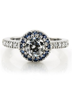 This classic halo engagement ring is furnished with sapphires and diamonds. Sapphires accent the center stone to bring out the beauty in it. Shank is bead set with diamonds to add to the sparkle of the engagement ring. Engagement ring is set with 16-1.3mm sapphires 0.26ct. tw. and 10-1.3mm diamonds 0.10ct. tw. This micro pave look engagement ring is available in 14k, 18k, platinum and palladium.