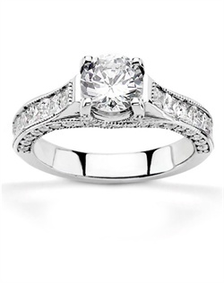 The newest creation of our design team. This engagement ring reflects needs of modern brides-to-be with inspiration of antique design. This engagement ring features 0.70 ct. tw. G-VS princess cut and 0.45 ct. tw. G-SI1 round diamonds. Center trellis will be finished capped prongs and can be set with 0.45 ct. - 1.30 ct. round diamond. This beautiful setting is available in 14k, 18k gold, platinum and palladium.