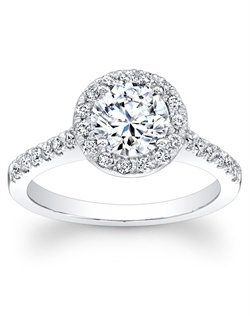 This diamond engagement ring features round brilliant cut diamonds pave set around your choice of center diamond as well as going half way around the shank.