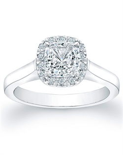 This stylish engagement ring setting features round brilliant pave-set diamonds, in a cushion halo shape, surrounding your choice of a center diamond.