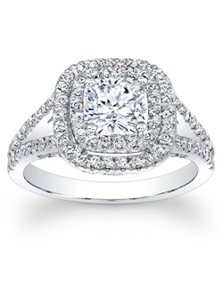 This beautiful diamond engagement ring features round brilliant cut diamonds in a double halo around the center stone of your choice as well as round brilliant cut diamonds down a split shank.