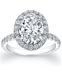 This spectacular engagement ring is completely hand-made and features round brilliant pave-set diamonds surrounding your choice of a center stone. In addition these pave diamonds go 4/5 the way around the band!
