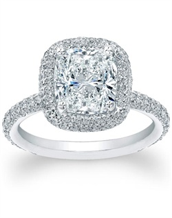 This exquisite hand-made engagement ring setting features tiny round brilliant diamonds which are pave-set 3/4 the way around the band as well as around the center stone and on the basket and prongs.