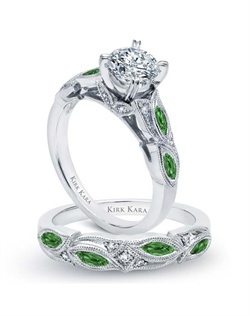Handcrafted engagement set from the Kirk Kara Dahlia collection. Engagement ring crafted with 0.04 carats of diamonds and 0.46 carats of marquise cut green tsavorites (center stone not included). Shown with matching wedding band crafted with 0.03 carats of diamonds and 0.46 carats of marquise cut green tsavorites. Available in platinum or 18K white, 18K yellow or 18K rose gold. All Kirk Kara designs are handcrafted and tailored to accommodate your customization requests.