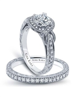Hand-engraved engagement set from the Kirk Kara Pirouetta collection. Engagement ring crafted with 0.25 carats of diamonds (center stone not included). Shown with matching wedding band crafted with 0.17 carats of diamonds. Available in platinum or 18K white, 18K yellow or 18K rose gold. All Kirk Kara designs are handcrafted and tailored to accommodate your customization requests.