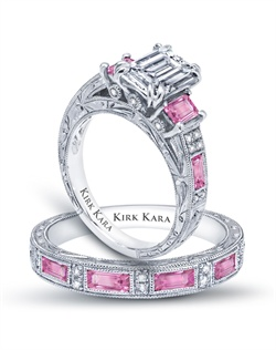 Hand-engraved engagement set from the Kirk Kara Charlotte collection. Engagement ring crafted with 0.11 carats of diamonds and 1.35 carats of baguette cut pink sapphires (center stone not included). Shown with matching wedding band crafted with 0.06 carats of diamonds and 0.74 carats of baguette cut pink sapphires. Available in platinum or 18K white, 18K yellow or 18K rose gold. All Kirk Kara designs are handcrafted and tailored to accommodate your customization requests.