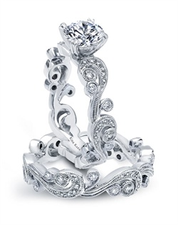 Handcrafted engagement set from the Kirk Kara Angelique collection. Engagement ring crafted with 0.21 carats of diamonds (center stone not included). Shown with matching wedding band crafted with 0.21 carats of diamonds. Available in platinum or 18K white, 18K yellow or 18K rose gold. All Kirk Kara designs are handcrafted and tailored to accommodate your customization requests.