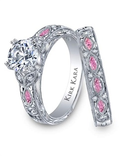 Hand-engraved engagement set from the Kirk Kara Dahlia collection. Engagement ring crafted with 0.12 carats of diamonds and 0.22 carats of marquise cut pink sapphires (center stone not included). Shown with matching wedding band crafted with 0.08 carats of diamonds and 0.35 carats of marquise cut pink sapphires. Available in platinum or 18K white, 18K yellow or 18K rose gold. All Kirk Kara designs are handcrafted and tailored to accommodate your customization requests.