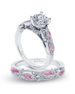 Handcrafted engagement set from the Kirk Kara Dahlia collection. Engagement ring crafted with 0.04 carats of diamonds and 0.43 carats of marquise cut pink sapphires (center stone not included). Shown with matching wedding band crafted with 0.03 carats of diamonds and 0.39 carats of marquise cut pink sapphires. Available in platinum or 18K white, 18K yellow or 18K rose gold. All Kirk Kara designs are handcrafted and tailored to accommodate your customization requests.