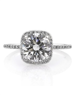 Truly breathtaking! This magnificently beautiful round brilliant cut diamond engagement ring features a stunning 2.11ct round diamond in the center. It is GIA certified at J-VS1. It faces up perfectly white like an H+ color diamond, and it is perfectly clear, even under 10X magnification! The cut is graded at Excellent! It sparkles tremendously! We custom made this high polish 18k white gold setting to showcase it perfectly! It features a halo of round diamonds set in a cushion shape and a row of round diamonds set down the shank in a micropave setting. We created it dainty and very thin, but strong, to make the center diamond pop! The connectors are also studded with round diamonds. You will be mesmerized by the sheer beauty of this piece! Amazing in every way!