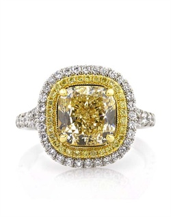 This magnificently beautiful custom-made fancy yellow cushion cut diamond ring is one in a million! It all starts with the astonishing 3.47ct cushion cut diamond set in the center. It is EGL certified at Fancy Light Yellow VS1. The color is very rich, vibrant and beautiful and the clarity is perfectly clear, even under 10X magnification! The magnificent platinum setting features a halo of fancy light yellow round diamonds and another row of white diamonds set around that. The combination is outstanding! The sides feature a split shank design set with round diamonds as well. All the diamonds are hand set in a micropave style setting that showcases each and every diamond perfectly with very little metal showing. It looks astonishing on the finger! A one of a kind piece you will cherish forever!