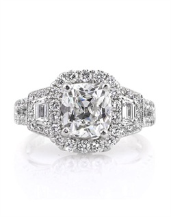 This astonishing antique cushion brilliant diamond ring will mesmerize you with its exceptional design, quality, and cut. It all starts with the magnificently beautiful 2.02ct antique cushion brilliant set in the center of this marvelous piece. It is GIA certified at F-SI1, exceptionally white and perfectly eye clean. It has such an outstanding cut and sparkles tremendously. The antique cushions feature the broader and more pronounced facets that reflect light in an outstanding way. It is accented by a halo of round diamonds that are prong set. The sides feature two step cut trapezoids with a row of round diamonds accenting them, and they are followed by two rows of round diamonds prong set down the shank. There is a small round diamond bezel set on the front and back of the ring as well. It is such a stunning piece! An outstanding piece at an exceptional value. You will cherish it forever!