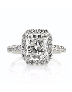 This mesmerizing radiant cut diamond engagement ring has an outstanding combination of quality, design, craftsmanship and let&#39;s not forget the size! The extraordinary 3.13ct radiant cut diamond set in the center is GIA certified at F-SI2. It is exceptionally white, incredibly brilliant and has an outstanding cut and shape! It is accented by a halo of round diamonds set around it and a row of round diamonds set down the shank in a micropave setting. All you see are brilliant diamonds with hardly any metal showing! The basket is also studded with round diamonds for an added touch of brilliance. This one of a kind piece is sure to be cherished forever. You will love it!