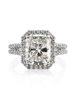 This remarkably beautiful radiant cut diamond ring will mesmerize you with its exceptional quality and amazing design! It all starts with the astonishing 4.00ct radiant cut diamond set in the center. It is GIA certified at H-VVS1, white and practically flawless! It has a stunning cut and sparkles tremendously! The custom made platinum setting features a halo of round diamonds set around it and a split shank set with two rows of round diamonds. The diamonds are all set in a micropave setting which showcase the diamonds perfectly with hardly any metal showing. It sits on the finger so beautifully! This one of a kind piece is sure to become a family heirloom you will cherish forever!