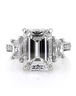 This remarkable emerald cut diamond ring is one of a kind and breathtaking! It is by far one of the most astonishing emerald cut diamonds you will ever see! This 5.58ct emerald cut diamond is GIA certified at G-VS2, perfectly white and clear! It is extremely hard to find magnificent diamonds such as this, especially in this weight range! It has a perfect shape and cut and sparkles beautifully! It is flanked by two large brilliant cut trapezoid diamonds weighing over half a carat each. The shank is set with a row of round diamonds set in a pave setting. This platinum masterpiece is handmade from top to bottom. Each one of the center prongs holding the center and accent diamonds are hand formed to fit each diamond perfectly and they are made to perfection! This piece is truly one in a million. Sure to become a family heirloom that will be cherished forever!
