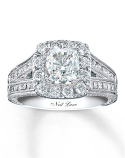 Neil Lane's vintage Hollywood style conjures romance and classic elegance in the Neil Lane Bridal® collection. Breathtaking round diamonds surround a cushion-cut diamond. Princess-cut diamonds reach up to support the center and round diamonds line the sides in a brilliant triumph of style. Neil Lane Bridal® rings are handcrafted and undergo a four-step polishing process to give each ring its beautiful shine and luster. This ring has a total diamond weight of 2 carats and features Neil Lane's signature inside the 14K white gold band.