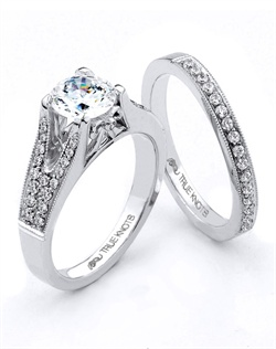Bold and beautiful describes this engagement ring set designed by TRUE KNOTS® for the TRUE WOMAN® Engagement Ring Collection. Sparkling with .20tcw of diamonds and available in platinum and gold.