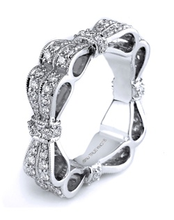 Reminiscent of sheer romance, originality and fun. This anniversary ring designed by TRUE KNOTS® for The Knot Collection is sensual and inspired by the warmth of an embrace. Sparkling with 1.26tcw of diamonds, this engagement ring is sure to win her heart. Available in platinum and gold.