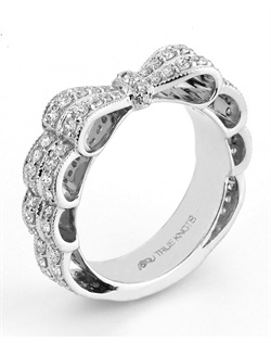 Reminiscent of sheer romance, this anniversary ring designed by TRUE KNOTS® for The Knot Collection is sensual and inspired by the warmth of an embrace. Sparkling with 1.04tcw of diamonds, this engagement ring is sure to impress. Available in platinum and gold.