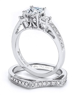 Reminiscent of sheer elegance, this Knot engagement ring designed by TRUE KNOTS® for The Knot Collection is sensual and inspired by the warmth of an embrace. Sparkling with 0.29tcw of diamonds, this engagement ring is sure to win her heart. Ring can accommodate any size round center (center not included). Available in platinum and gold.