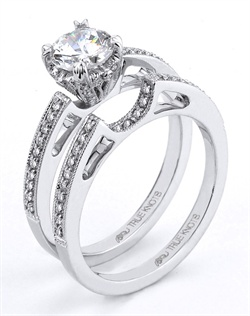 "Reminiscent of sheer femininity, this Knot engagement ring designed by TRUE KNOTS® for The Knot Collection is sensual and inspired by the warmth of an embrace. Sparkling with 0.17tcw of diamonds, this engagement ring is sure to ""wow"". Ring can accommodate any size round center (center not included). Available in platinum and gold."