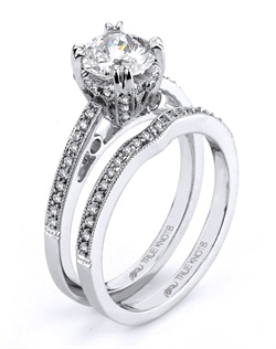 Reminiscent of sheer femininity, this Knot engagement ring designed by TRUE KNOTS® for The Knot Collection is sensual and inspired by the warmth of an embrace. Sparkling with 0.17tcw of diamonds, this engagement ring is sure to win her heart. Ring can accommodate any size round center (center not included). Available in platinum and gold.