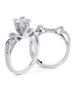Reminiscent of sheer elegance, this Knot engagement ring designed by TRUE KNOTS® for The Knot Collection is sensual and inspired by the warmth of an embrace. Sparkling with 0.26tcw of diamonds, this engagement ring is sure to dazzle. Ring can accommodate any size round center (center not included). Available in platinum and gold.