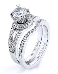 Reminiscent of sheer femininity, this Knot engagement ring designed by TRUE KNOTS® for The Knot Collection is sensual and inspired by the warmth of an embrace. Sparkling with 0.34tcw of diamonds, this engagement ring is sure to win her heart. Ring can accommodate any size round center (center not included). Available in platinum and gold.