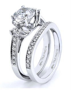Modern arches of love are shown here in this engagement ring designed by TRUE KNOTS® for The Knot Collection. Sparkling with 0.33tcw of round diamonds, it's sure to dazzle her heart. Available in platinum and gold.