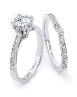 Simply classic with ornate detail describes this engagement ring designed by TRUE KNOTS® for The Knot Collection. Sparkling with 0.18tcw of round diamonds and available in platinum and gold.