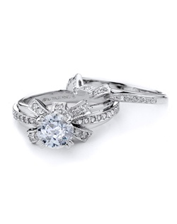 Tell her she is the one with this dainty-licious knot engagement ring designed by TRUE KNOTS® for the The Knot Collection. Shining with 0.46tcw of round diamonds, it's sure to impress. Available in platinum and gold (center not included).