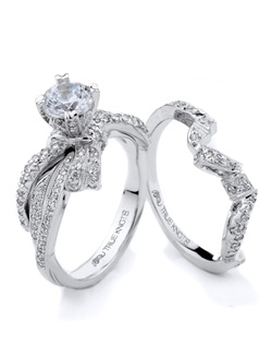 Reminiscent of sheer femininity, this Knot engagement ring designed by TRUE KNOTS® for The Knot Collection is sensual and inspired by the warmth of an embrace. Sparkling with 0.41tcw of diamonds, this engagement ring is sure to win her heart. Ring can accommodate any size round center. (center not included). Available in platinum and gold.
